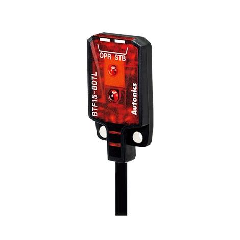 سنسور نوری رفلکتوری سه سیمه NPN با تغذیه 24-12 ولت DC و فاصله تشخیص 15 میلی متری BTF آتونیکس